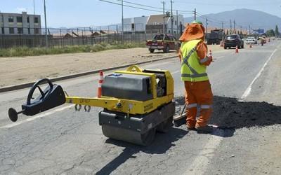 Machali repara calles