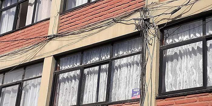 Logran retiro de cables en desuso de departamento de Rancagua